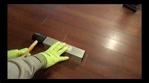 Anita Johnston Demonstrating flooring install